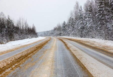 Dangerous road in the winter treated reagent photo