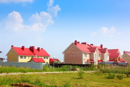 cottage village on beautiful sky background