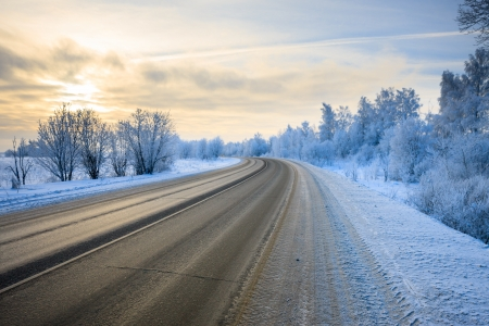 road in winter at dawn Stock Photo