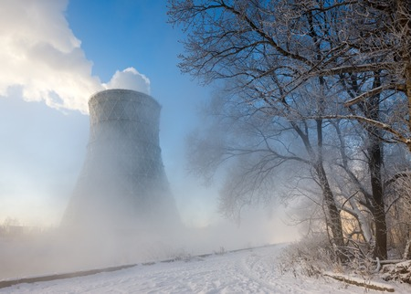 thermal power plant in winter in  fog photo