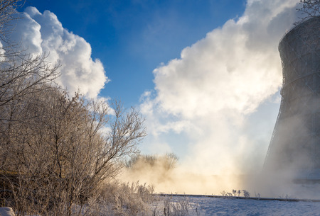 reprocessing: thermal power plant in winter in the fog