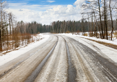 rut: winter dangerous road leading to the forest