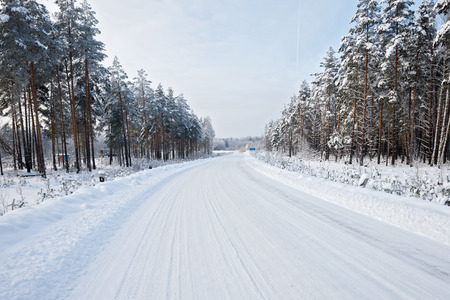 road in winter   dangerous turn photo