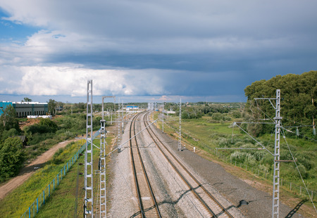 railway points:  railway line stretching into the horizon on a background cloudy sky Stock Photo