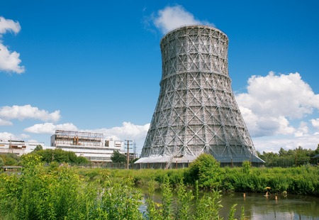 Steaming cooling towers on  pond photo