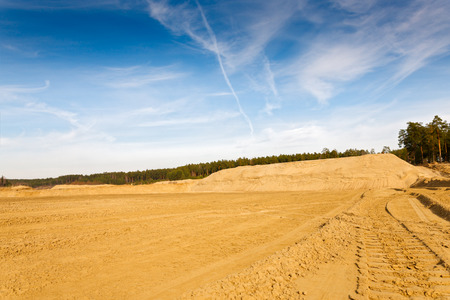 sand quarry: quarry for the extraction of sand against the blue sky