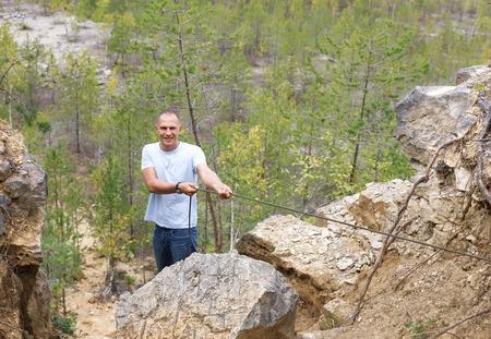 rockclimb: man overcomes rocky Wake up holding a rope