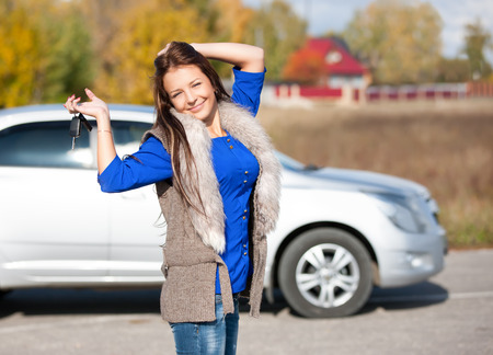 car driver woman smiling showing new car keys photo