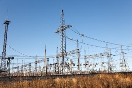 isolator high voltage: Power transformer in substation  against  blue sky