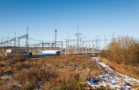 isolator high voltage: Electric power substation against  blue sky