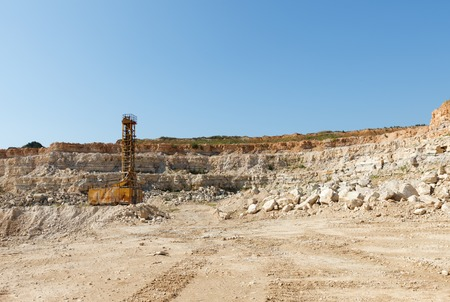 Limestone in the development of rock.Derrick for laying a charge of TNT photo