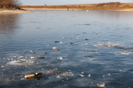 fishing rod and catch a fish on ice fishing Stock Photo