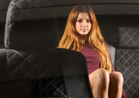 Sexy woman in back seat of car