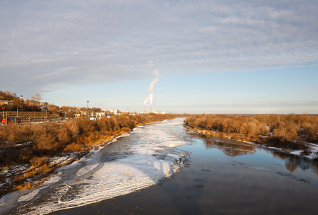 view of  river near  town on a frosty day photo