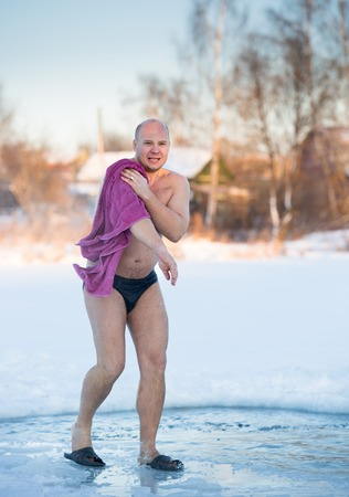 cheerful man after swimming in cold water