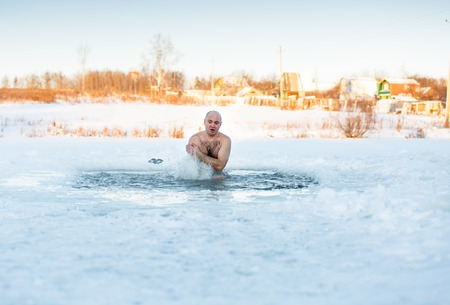 adult man swimming in cold water a frosty morning