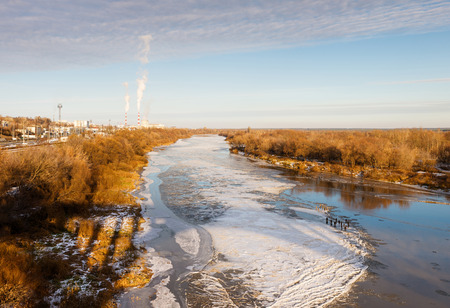 top view of  crust of ice covering the river in frosty day photo