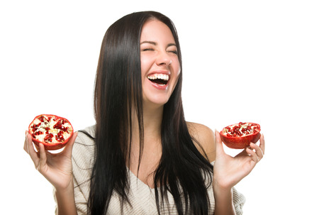 happy laughing girl with fruit in their hands