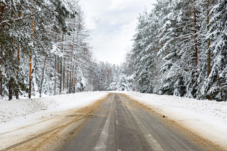snow road: Danger and fast turn at the icy snow road