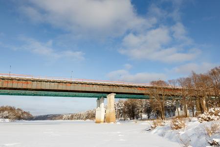 frigid: bridge in frigid weather with ice and sunny skies