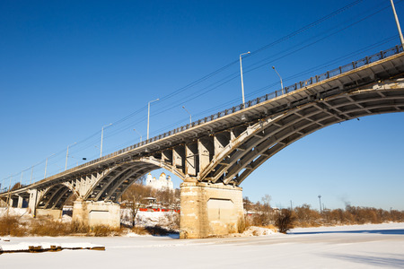 frigid: Winter view of  bridge in frigid river