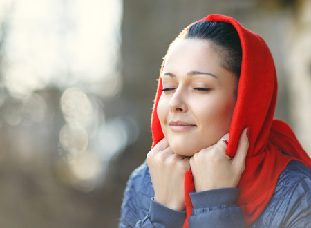 red scarf: Happy Woman Enjoying Nature wearing red scarf Stock Photo
