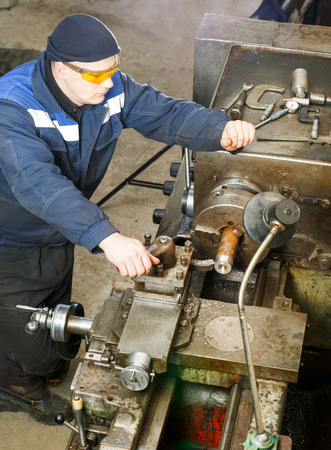 turner: Turner is working on the machine. metal processing