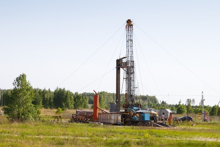 Mobile rig at work drilling the oil well Stock Photo