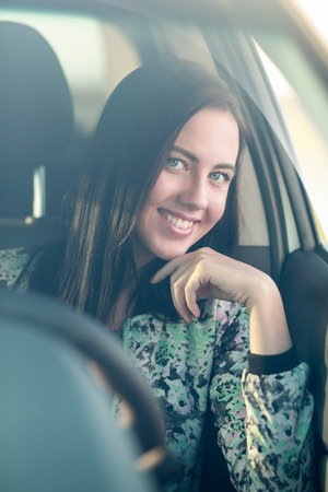woman driving car: Young woman driving her car