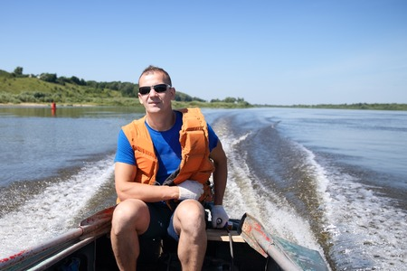 lifejacket: Man in a lifejacket on a boat is moving Stock Photo