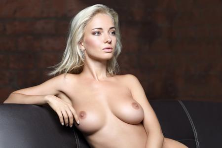 studio portrait of a beautiful woman posing naked