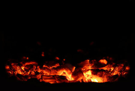 torrid: Hot Charcoal in the BBQ Grill Pit Stock Photo