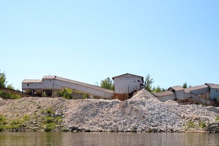 macadam: old quarry plant on the river bank