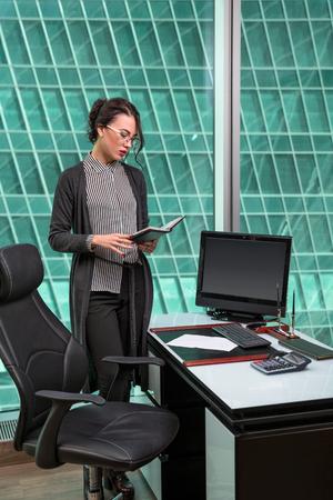 sky scraper: portrait of  girl office worker inside the office building