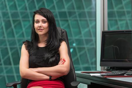 sky scraper: beautiful modern businesswoman inside the office building Stock Photo