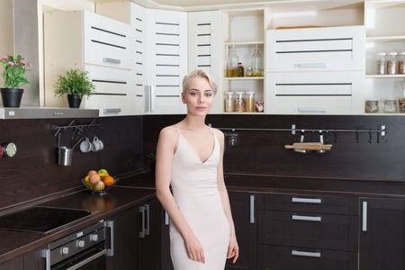 rich people: portrait of the blonde with in modern kitchen Stock Photo