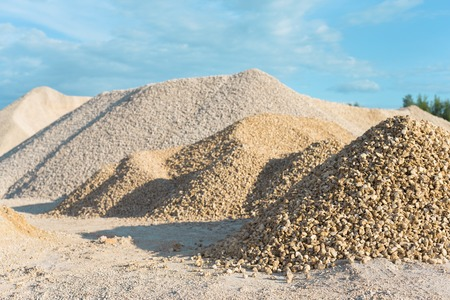 sand quarry: pile of limestone quarry on background of blue sky Stock Photo