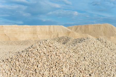 macadam: macadam in the development of rock on background of blue sky