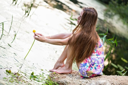 girl takes water lily in the lake