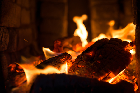 lurid: embers with flames in the stone oven