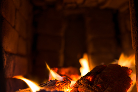 lurid: embers with flames in a traditional oven