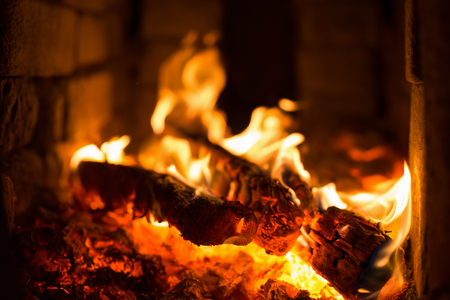 lurid: wood and coal burning in a fireplace
