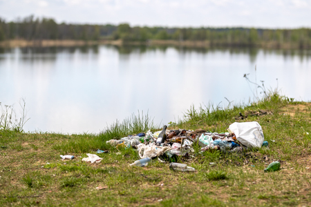 A lot of garbage at the tourist destination on the lake Stock Photo