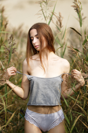 Outdoors portrait of a beautiful woman undresses