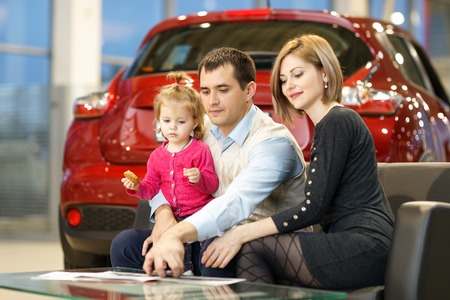 Family buying new car in dealership 스톡 콘텐츠