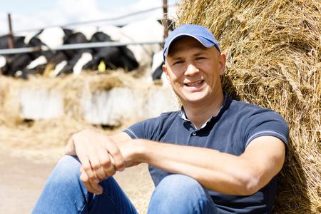 Farmer portrait against background of herd of animal husbandry Reklamní fotografie
