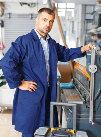portrait of a working man at a printer studio