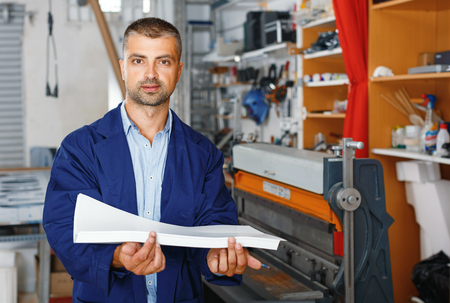 profession,job,people,polygraphy-workman in special clothes with paper