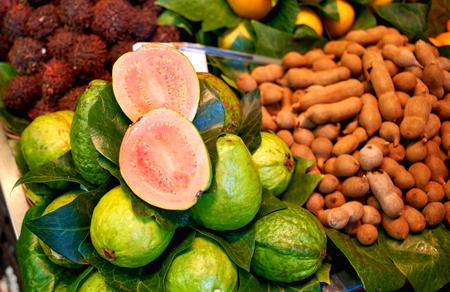 Fresh fruits in market. Exotic fresh fruits on a market. Papaya, dragon fruit, kiwi, passion fruit.