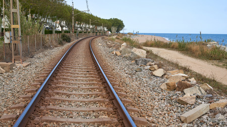 Empty rail road leading paths go to the grizont with sea